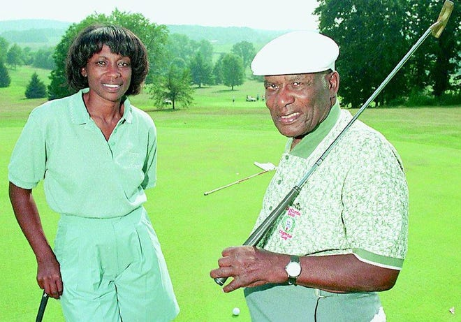 Bill Powell and his daughter Renee are seen on the 16th green of their Clearview Golf Club.