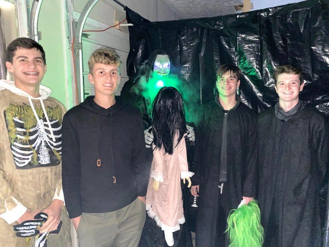 Jackson senior golfer Zach Sieverts and his friends created a haunted house in his garage for charity. Those pictured are (left to right) Ben Morena, Sieverts, Louie Thomas and Ben Ramold.