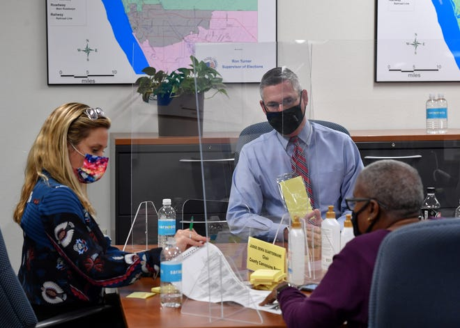 Members of the Sarasota County Canvassing Board, Judge Erika Quartermaine, left, Supervisor of Elections Ron Turner and former County Commissioner Carolyn Mason examine ballots Nov. 3 as results from voting precincts are reported.