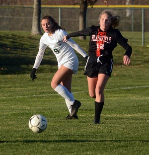 Griswold's Ruby Logan, left, and Plainfield's Hannah Price battle for the ball during their game Monday in Plainfield.