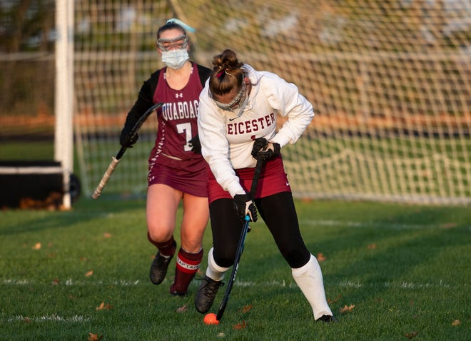 Quaboag's Darian Shepherd, left, challenges Leicester's Nicole Berard during Tuesday's field hockey game in Leicester.