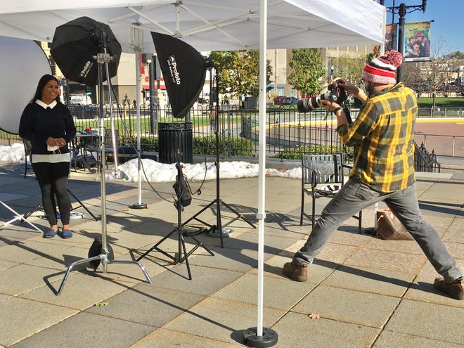 "At City Hall, photographer Matt Wright captures the image of North High School Spanish teacher Teranie Tirado on Wednesday, part of the ""I Am Worcester"" project."