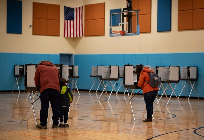 Last minute voters cast their ballots at Nelson Place Elementary School in Worcester during the final hours of Election Day on Tuesday.