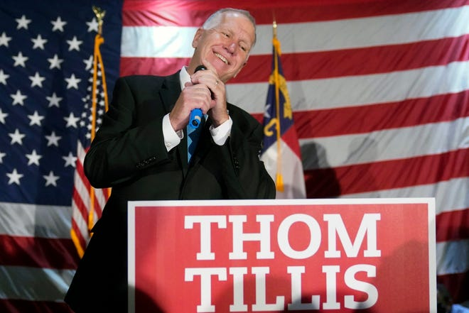 Sen. Thom Tillis, R-N.C., speaks to supporters at a election night rally Tuesday, Nov. 3, 2020, in Mooresville, N.C. (AP Photo/Chris Carlson)