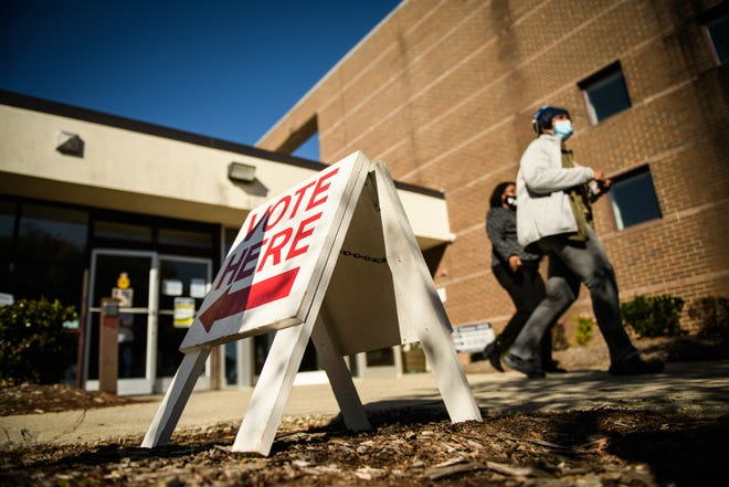 Voters leave the polling site at Smith Recreation Center on Tuesday, Nov. 3, 2020.