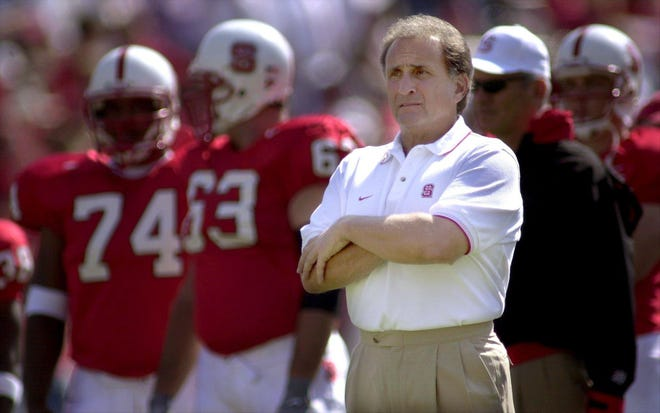 Chuck Amato stands on the sidelines with his Wolfpack squad in 2000.  An NC State alum who played football and wrestled for the Pack in the 1960s, Amato served as an assistant coach for the football team for nine years beginning in 1971 and he was the Wolfpack's head coach from 2000-'06.