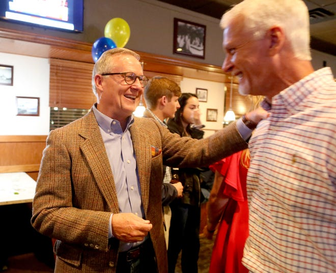 """Charles """"Chuck"""" Clemons, left, who won his reelection race for the state House of Representatives District 21seat, is congratulated by state Sen. Keith Perry during the victory party held at the Copper Monkey West near Tioga west of Gainesville on Tuesday night."""