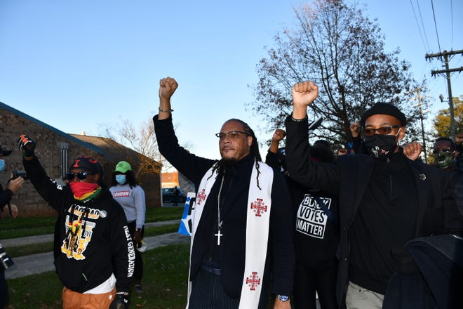 Rev. Gregory Drumwright (middle) leads hundreds through the streets of Graham during a march held Tuesday, Nov. 3. This march took place just days after another march through Graham turned violent when law enforcement agents pepper-sprayed the crowd and arrested several demonstrators. Tuesday's march was much more peaceful.