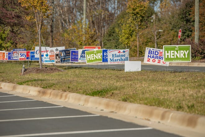 FILE - Candidates' signs line the road and parking lot at Elon Elementary School. State lawmakers recently discussed the pros of engaging as many voters as possible.