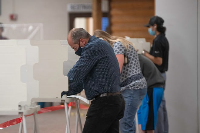 Voters cast their ballots at the Colorado State Fairgrounds in-person on Election Day.