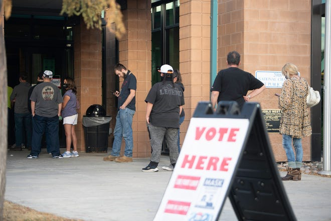 Voters wait in line to cast their ballots at the Pueblo West Library on Election Day.