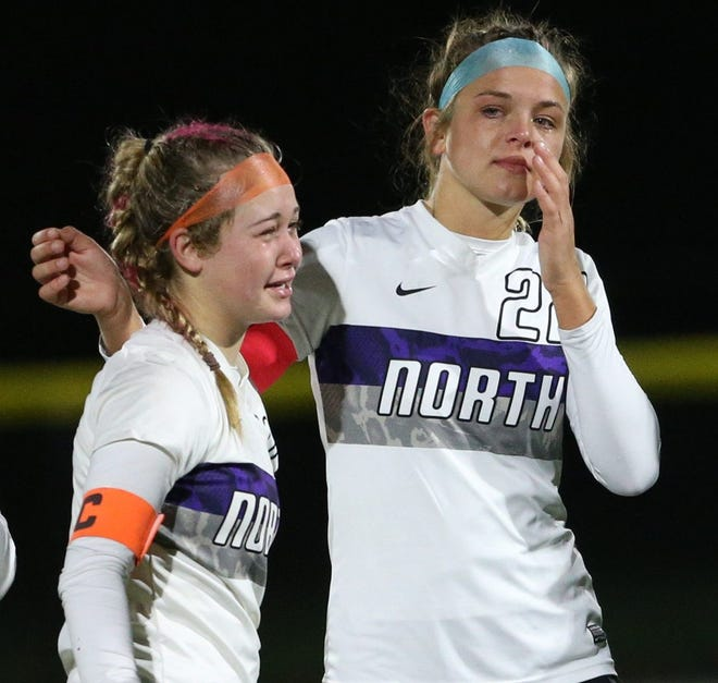 North's Tori Haggit, left, and Kara Thomas show their disappointment after a 2-1 loss (4-3 shootout) to Watterson in a Division I regional semifinal Nov. 3.  The Panthers finished 13-4-3.
