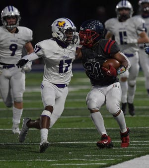 DeSales' Ayan Comedy makes the stop on Hartley's Nyal Johnson during the visiting Stallions' 16-14 win Oct. 2. DeSales plays host to the Hawks on Friday, Nov. 6, in the Division III, Region 11 final.