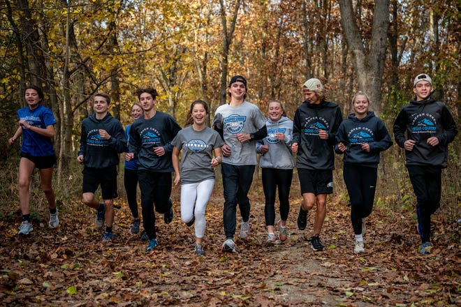 Top 10 runners of Harper Creek High School pose for a picture on Monday, Nov. 2, 2020 at Ott Biological Preserve in Battle Creek, Mich.
