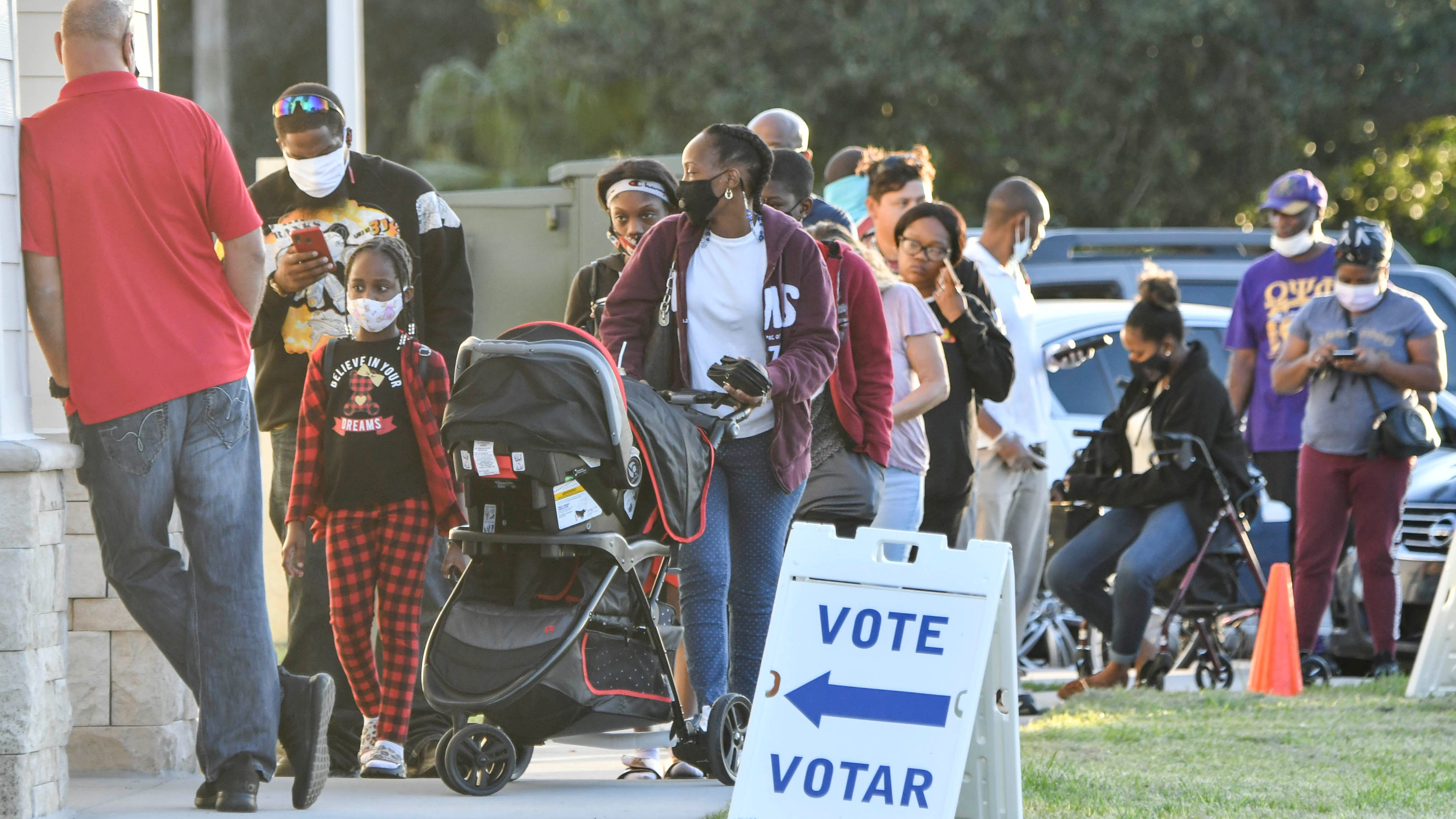 As the sun goes down people wait in a short line to vote at the Joe Lee Smith Center in Cocoa, FL Mandatory Credit: Craig Bailey/FLORIDA TODAY via USA TODAY NETWORK