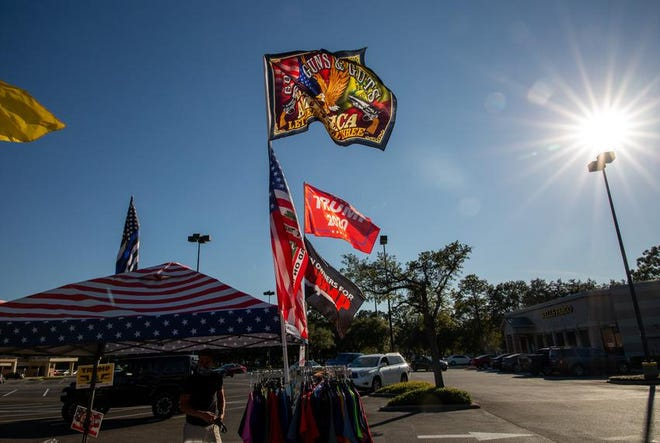 Flags wave on Election Day at a merchandise stand in Kingwood.