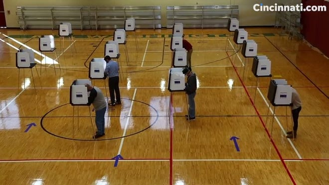 Voters throughout Greater Cincinnati make their way to the polls amid the coronavirus pandemic.