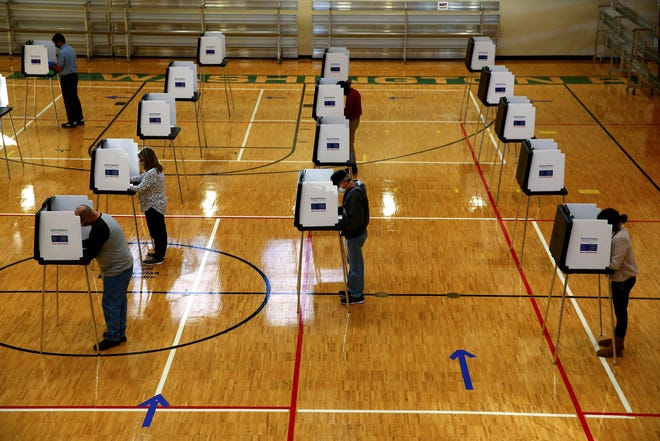 Voters use physically distanced booths, Tuesday, Nov. 3, 2020, at the Mount Washington Recreation Center polling location in Cincinnati.