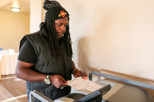 Patrill Ellis, a felon, votes for first time.
