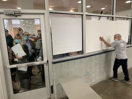 A window is being shaded outside the room where the absentee ballots are being counted at the TCF center in Detroit on November 4, 2020. Police had to repel the crowd as they argued to be allowed into the arena. Counting votes in Detroit.