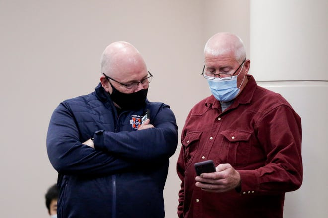 Tippecanoe County commissioner David Byers, right, looks at his phone with commissioner Tracy Brown, as 2020 general election results are slowly released at the Tippecanoe County Office Building, Tuesday, Nov. 3, 2020 in Lafayette.
