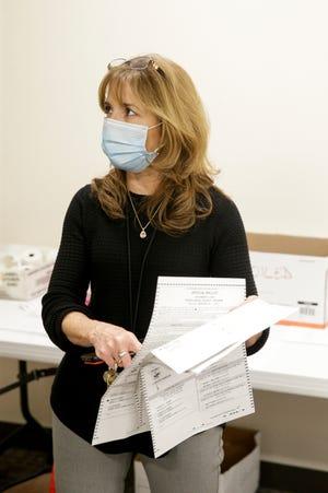 Tippecanoe County Clerk Julie Roush explains the mail-in ballot scanning process, Tuesday, Nov. 3, 2020 in Lafayette.