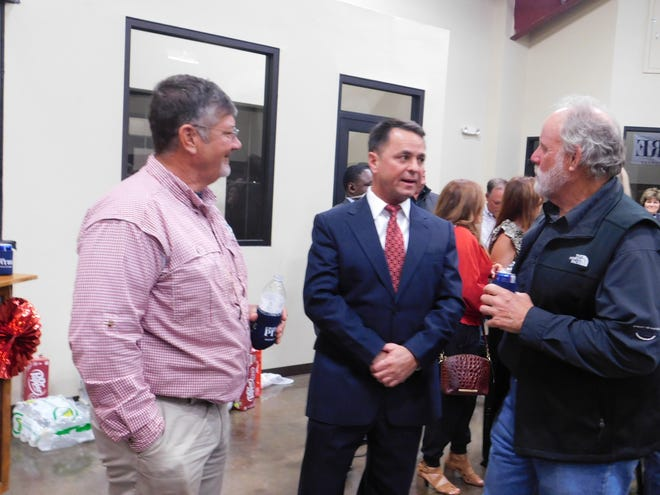 Chad Pitre, center, and two supporters discuss election results during a post-election party at the St. Landry Equine Center Tuesday, Nov. 3, 2020. Voters selected Pitre as the St. Landry Parish District Attorney over incumbent Charles Cravins.