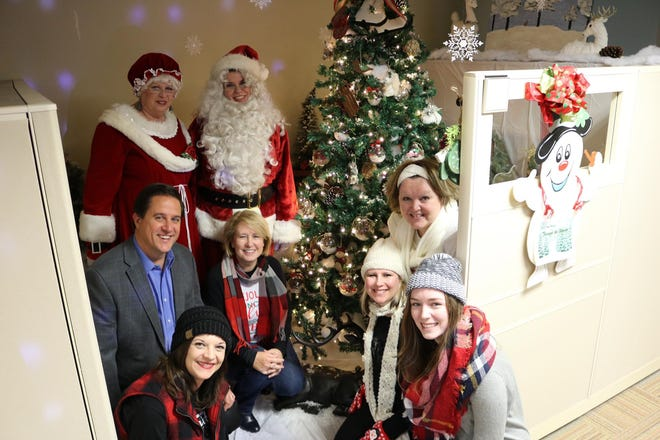 Lipscomb & Pitts Insurance employees participated in a Christmas tree decorating contest last year, one of many activities the company organized to encourage team bonding.