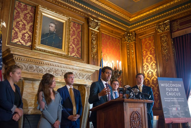 Steven Olikara, founder and CEO of Millennial Action Project, at the Wisconsin State Capitol in 2017 launching the Wisconsin Future Caucus with millennial legislators. It's the only bipartisan caucus in the state legislature.