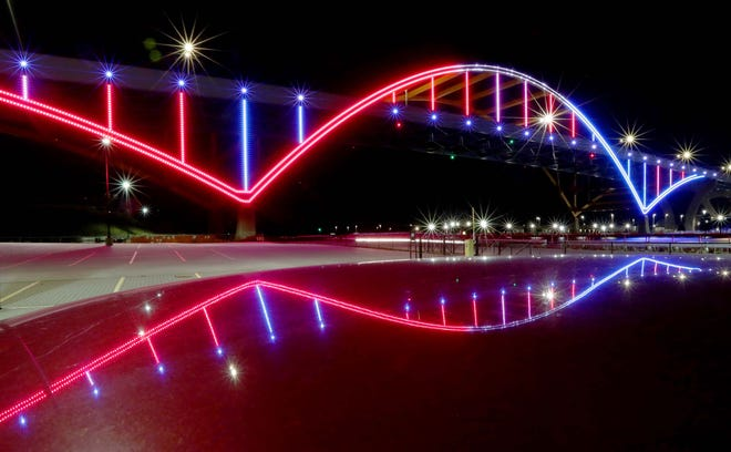 The Hoan bridge was lit in red, and blue in Milwaukee, Wis. on election day, Tuesday, Nov. 3, 2020.