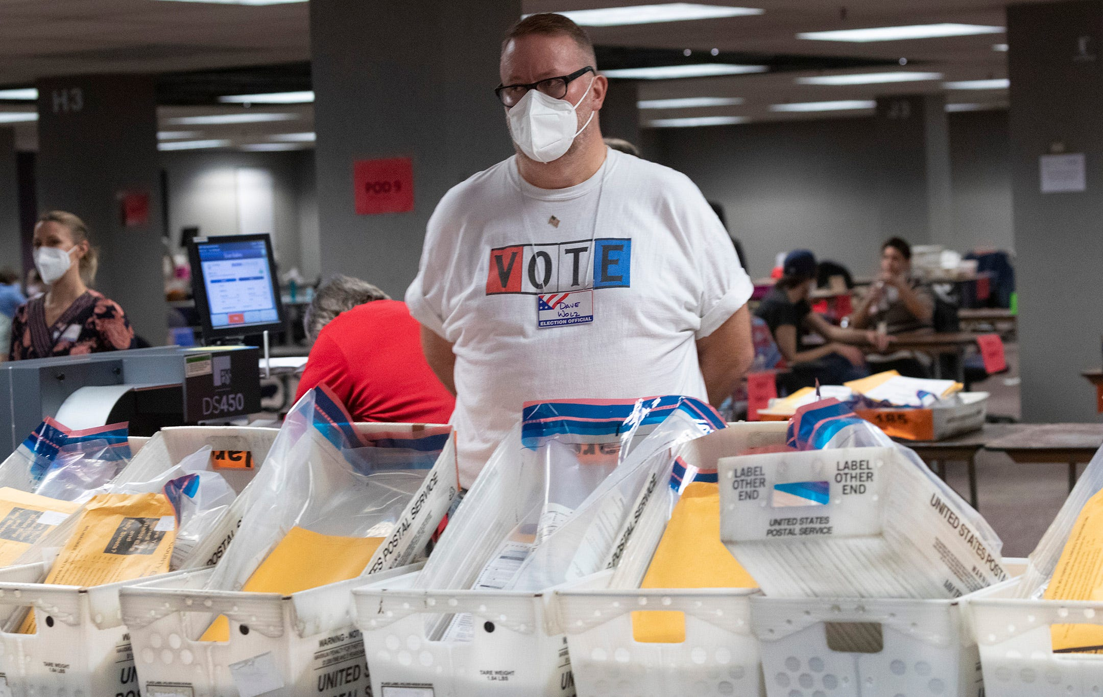 Workers process ballots Tuesday at the City of Milwaukee Central Count Facility, 501 W. Michigan Ave. Split into three shifts, tabulators are positioned in pods of around 50 people to limit the amount of interaction among the hundreds working there because of the coronavirus.