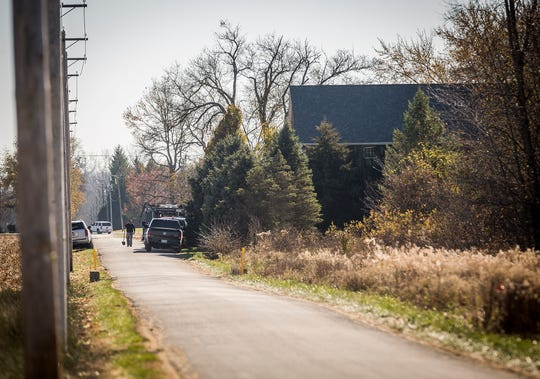 Delaware County sheriff's deputies and agents with the FBI investigate a property on Delaware County Road 725-W, between River and Division roads in Yorktown, on Wednesday, Nov. 4, 2020.