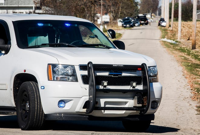 County police and officers with the Indiana FBI investigate a property on County Road 725 West near River Road in Yorktown Wednesday, Nov. 4, 2020.