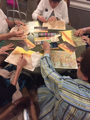 A group of women draw in an art therapy session led by Angel Duncan in Naples, Florida.