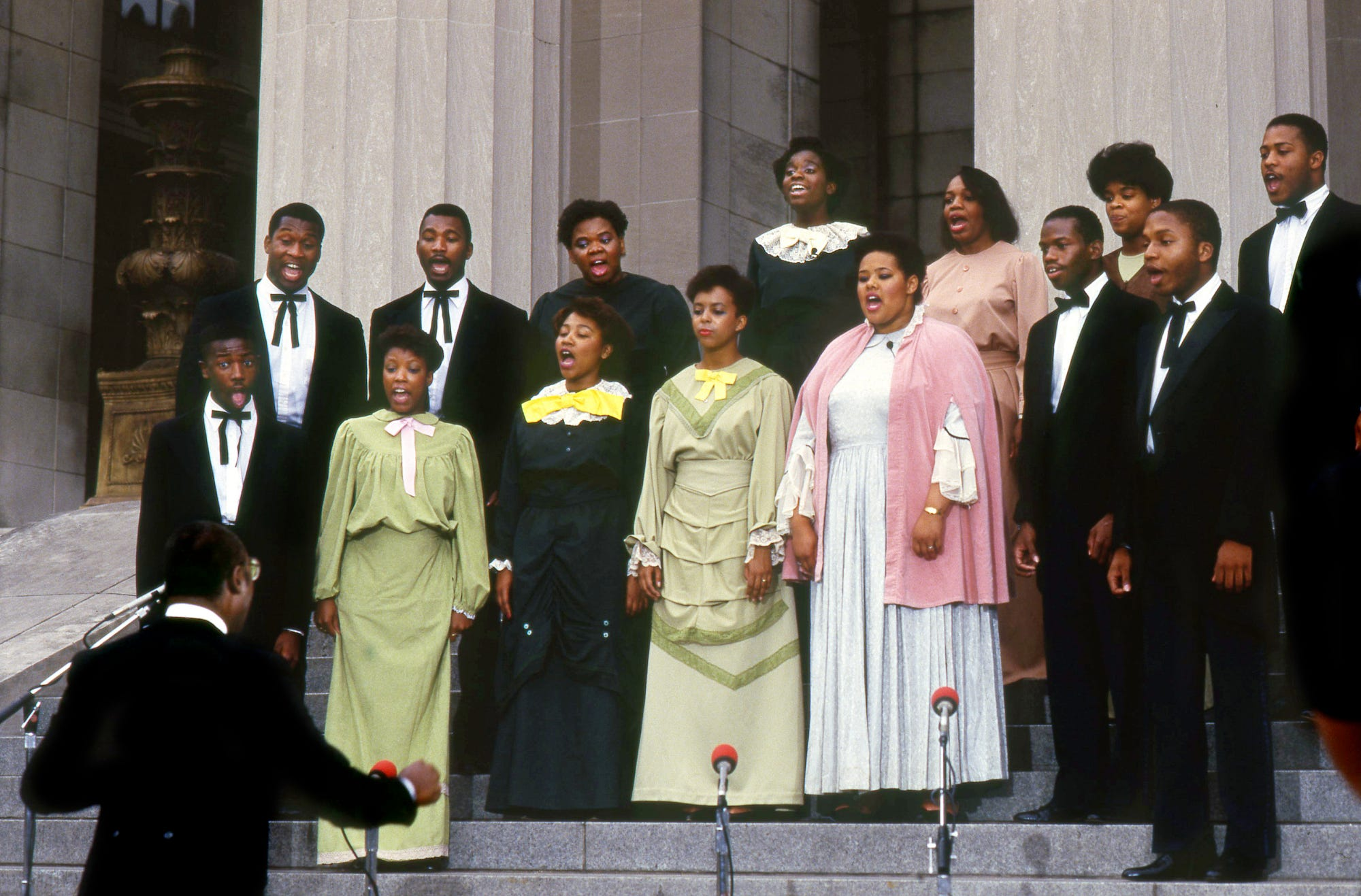 """The Fisk Jubilee Singers, wearing outfits that the founding members could have worn in 1871, perform on the steps of the War Memorial building during the live Nashville show of NBC's """"Today"""" show May 19, 1987."""