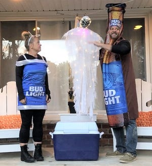 Garden City resident Matt Thompson (pictured with wife Hollie) developed a socially-distanced plan to distribute candy (and Bud Lights) on Halloween.