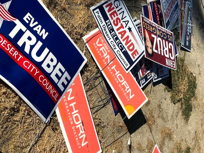 Political campaign signs are scattered in a vacant lot on Wednesday, November 4, 2020.