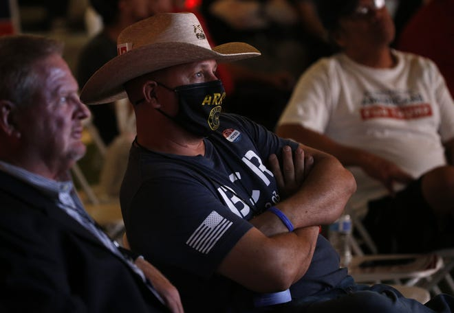 Republican voters watch returns and hear the news that Fox has called Arizona for the Democratic Biden campaign during the Republican Election Night Watch Party in Chandler on Nov. 3, 2020.