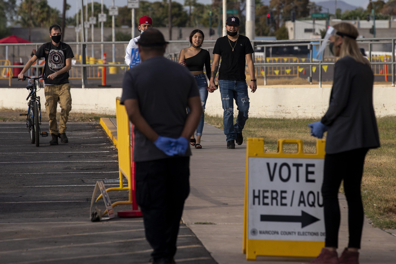 People walk to vote at the Arizona Veterans Memorial Coliseum in Phoenix on Nov. 3, 2020.