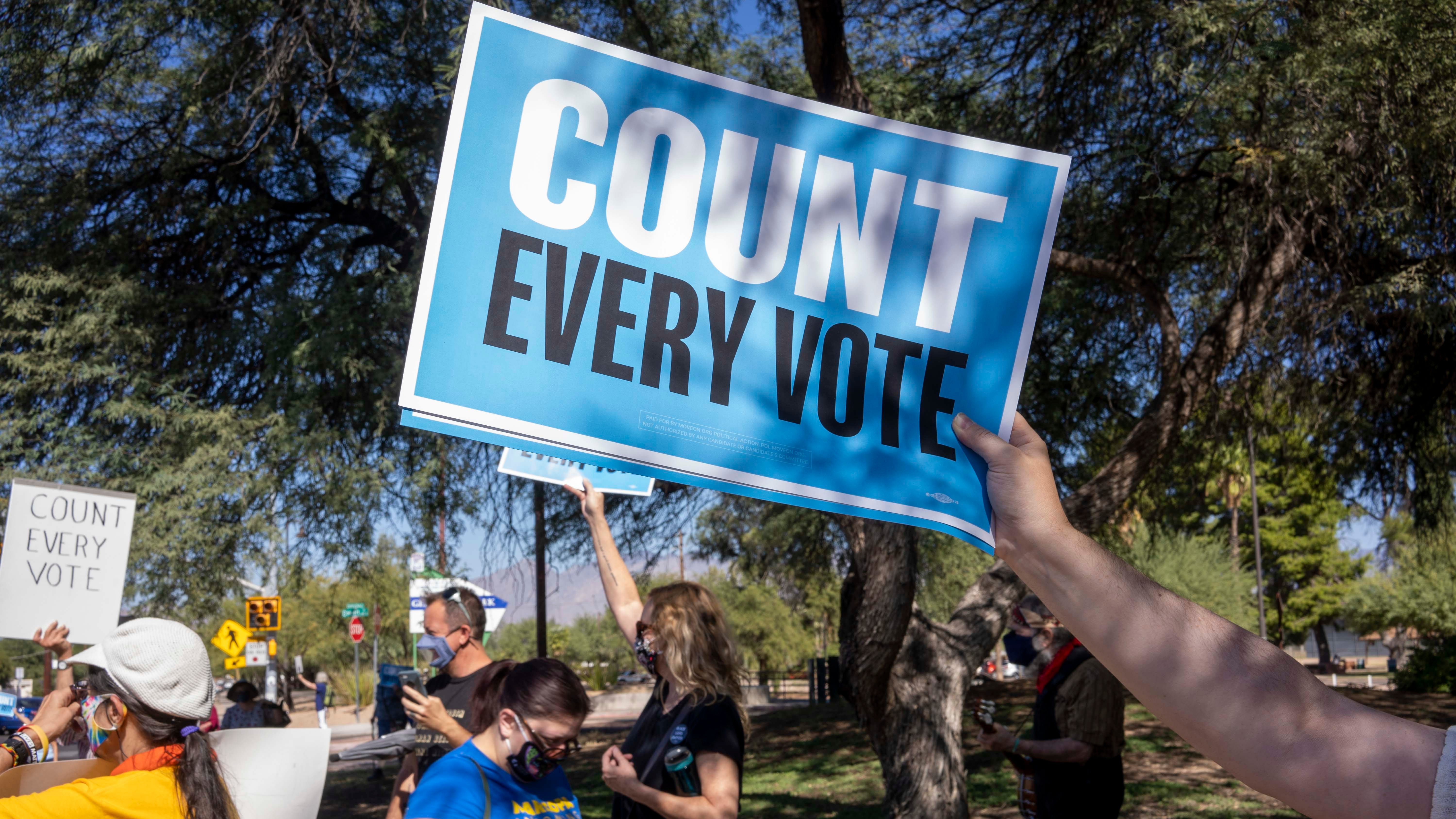 More than 50 people, mostly self-identified Democrats and supporters for Democratic candidate Joe Biden, gather for a rally in central Tucson on Nov. 4, 2020. They demanded that all votes cast in this year's presidential election be counted.