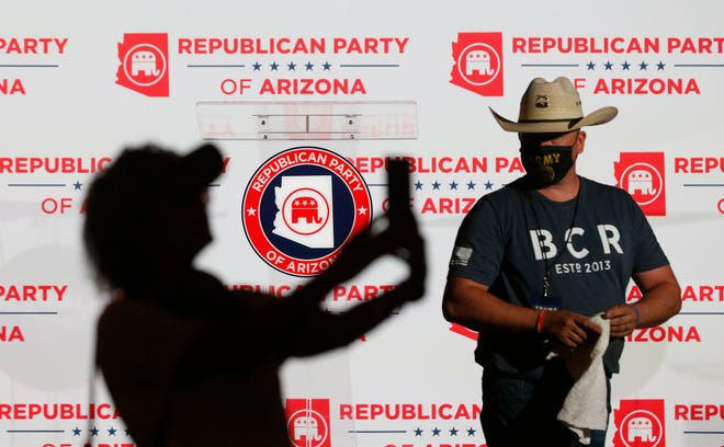 A Republican takes a selfie as the stage is prepped during the Republican Election Night Watch Party in Chandler, Arizona on Nov. 3, 2020.