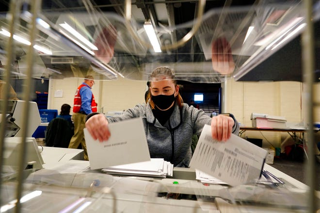 Chester County, Pa., election worker Kristina Sladek opens mail-in and absentee ballots for the 2020 General Election in the United States at West Chester University, Tuesday, Nov. 3, 2020, in West Chester, Pa. (AP Photo/Matt Slocum)