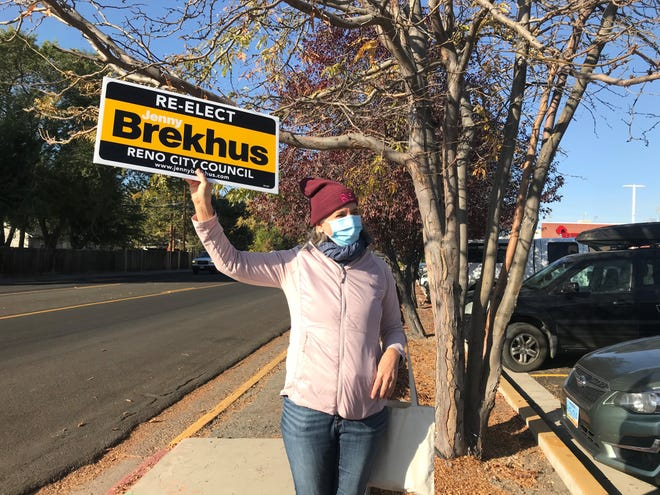 Jenny Brekhus campaigns outside the polling location at Reno High School on Tuesday morning, Nov. 3, 2020.