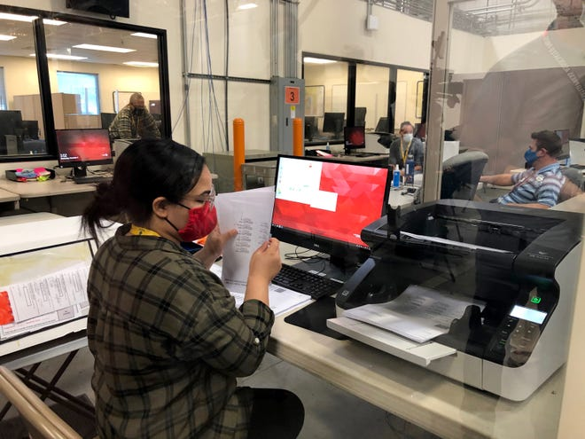 Clark County election workers process ballots Nov. 4, 2020.