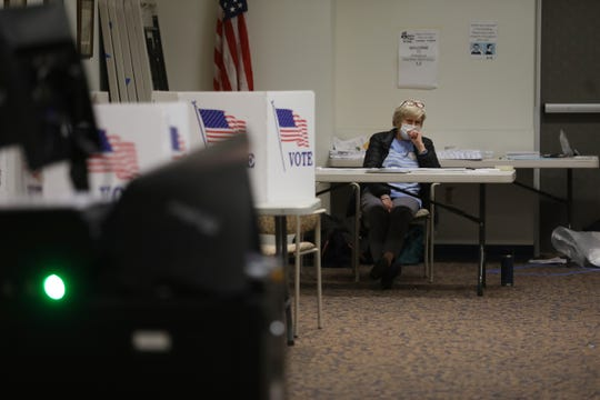 Pittsford Community Library polling site is empty early evening on Election Night Nov.3, 2020.  Patricia Costello, election inspector, waits for a voter to come in.