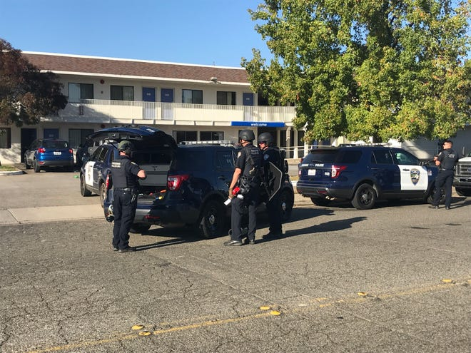 Redding police stand outside the Motel 6 on Twin View on Wednesday morning, Nov. 4, 2020.