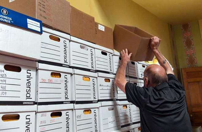 An election worker stacks boxes of processed absentee ballot envelopes on Tuesday, November 3, at the Old Courthouse Museum in Sioux Falls.