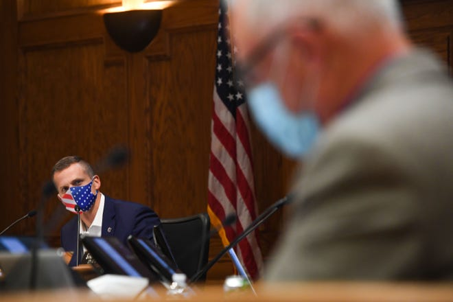 Mayor Paul TenHaken listens to counselor Curt Soehl regarding the first reading of a possible mask mandate at a city council meeting on Tuesday, November 3, at Carnegie Town Hall in Sioux Falls.