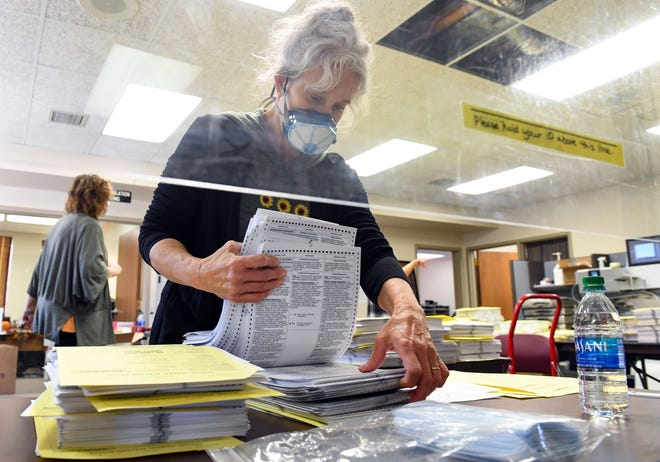 Sharon Litz stacks ballots to be counted on Wednesday, November 4, at Election Center in Sioux Falls.
