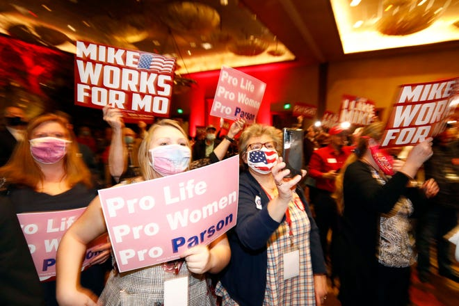 Supporters of Governor Parson welcome him at the Republican watch party at the White River Room in Springfield on November 3, 2020.